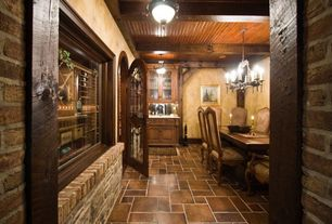 Traditional Wine Cellar with flush light, French doors, limestone floors, Exposed beam, Built-in bookshelf