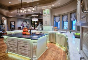 Traditional Kitchen with Glass panel, Raised panel, Subway Tile, Undermount sink, Crown molding, Complex marble counters