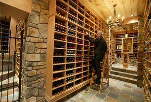 Craftsman Wine Cellar with Built-in bookshelf, Chandelier, terracotta tile floors