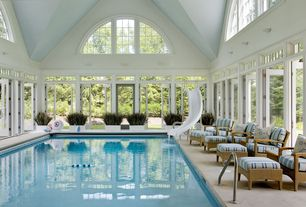 Traditional Swimming Pool with Arched windows, Transom window, Pool slide, Indoor pool, French doors, picture window