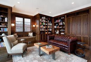 Contemporary Living Room with can lights, Hardwood floors, Built-in bookshelf, bedroom reading light, Crown molding, Casement