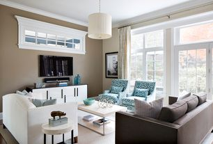 Contemporary Living Room with Pendant light, Built-in bookshelf, French doors, Crown molding, Hardwood floors