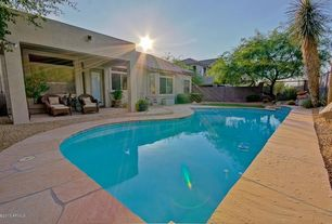 Traditional Swimming Pool with Fence, French doors, exterior stone floors