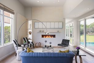Contemporary Living Room with High ceiling, Hardwood floors