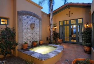 Mediterranean Patio with French doors, Fence, Terra Cotta & Blue Lace Talavera Mexican Tile, Transom window, Raised beds