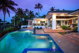Tropical Swimming Pool with Other Pool Type, French doors, Deck Railing, exterior stone floors, picture window, Pathway