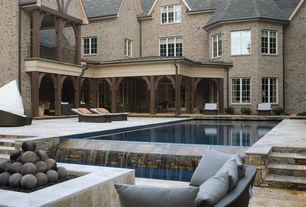 Traditional Swimming Pool with Deck Railing, Casement, Lap pool, Fountain, Pathway, Fire pit, exterior stone floors