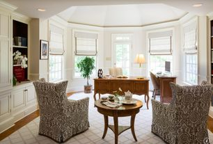 Traditional Home Office with Transom window, Built-in bookshelf, Hardwood floors, Crown molding, Chair rail, High ceiling