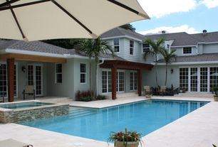 Traditional Swimming Pool with 9 ft. aluminum patio umbrella in sunbrella spectrum sand, Pool with hot tub, French doors