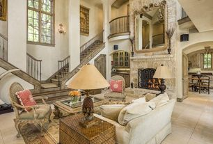 Traditional Great Room with Pottery barn - expedition cube, Fireplace, Arched window, Wall sconce, Paint, specialty door