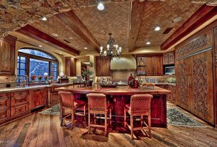 Mediterranean Kitchen with Farmhouse sink, U-shaped, dishwasher, full backsplash, Arched window, electric cooktop, Stone Tile