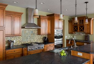 Craftsman Kitchen with Kitchen island, Multiple Sinks, Glass panel, Standard height, Wine refrigerator, Soapstone counters