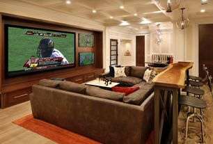 Eclectic Home Theater with Crown molding, Box ceiling, Pendant light, specialty door, Chair rail, Laminate floors