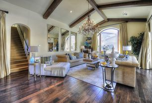 Contemporary Living Room with High ceiling, Chandelier, Exposed beam, Hardwood floors, Arched window