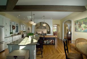 Country Kitchen with Undermount sink, Pendant light, Inset cabinets, Glass panel, full backsplash, Stone Tile, Arched window