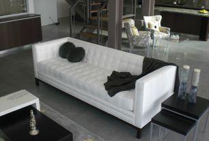 Modern Living Room with Coda industries stitch bowie sofa, Concrete floors, Columns, Caroline nesting table set