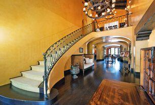 Mediterranean Staircase with Hardwood floors, Exposed beam, Chandelier, Cathedral ceiling, specialty door