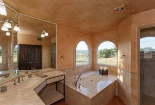 Mediterranean Master Bathroom with Limestone counters, Wall Tiles, Standard height, Faux finish paint, Arched window, Vanity