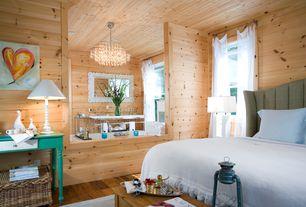 Rustic Master Bedroom with Chandelier, can lights, double-hung window, Art desk, Standard height, Hardwood floors