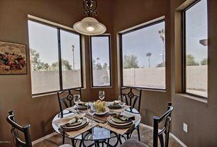 Mediterranean Dining Room with High ceiling, Pendant light, stone tile floors, picture window, travertine tile floors