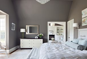 Contemporary Master Bedroom with Metal rectangular wall mirror, Casement, Wall sconce, Laminate floors, Paint, six panel door