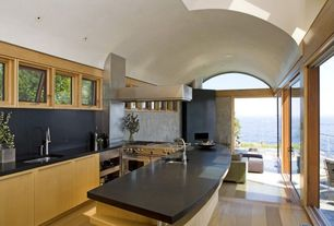 Contemporary Kitchen with Undermount sink, Glass panel door, High ceiling, Wine refrigerator, Galley, Soapstone, Flush