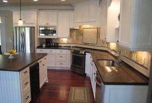 Traditional Kitchen with Stonemark Granite-Granite Countertop in Absolute Black, Pendant light, Undermount sink, Custom hood