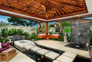 Tropical Master Bathroom with European Cabinets, Ceiling fan, Wood counters, Rain shower, Flush, Exposed beam, High ceiling