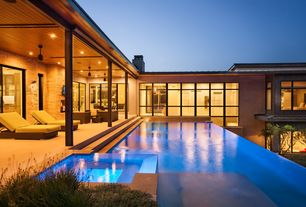 Contemporary Swimming Pool with picture window, French doors, Infinity pool, exterior tile floors