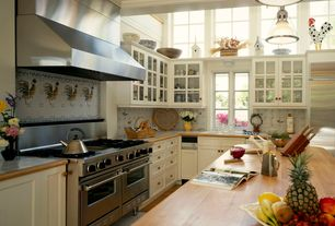 Country Kitchen with stone tile floors, full backsplash, Wall Hood, Flush, large ceramic tile counters, Undermount sink