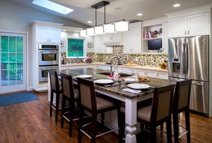 Traditional Kitchen with Limestone counters, Ceramic Tile, Flat panel cabinets, Hardwood floors, French doors, Kitchen island