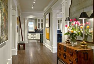 Traditional Hallway with Paint, Crown molding, Hardwood floors, Standard height, can lights