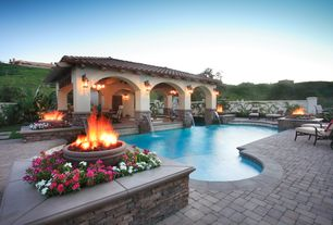 Mediterranean Swimming Pool with Exterior stucco walls, Other Pool Type, Fountain, Fire pit, Fence, Cabana