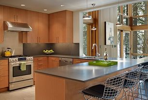 Contemporary Kitchen with Flat panel cabinets, slate tile floors, Bertoia - wire counter stool, chrome finish, Silestone