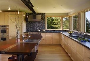 Modern Kitchen with Flush, 1-light brushed nickel mini-pendant, Breakfast bar, L-shaped, Wood counters, Concrete counterop