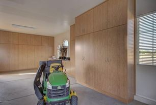 Contemporary Garage with limestone floors