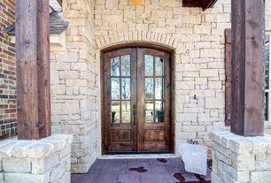 Rustic Front Door with exterior tile floors, picture window, French doors, exterior terracotta tile floors