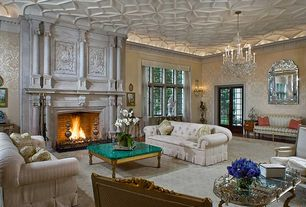 Traditional Living Room with interior wallpaper, Crown molding, Wall sconce, Chandelier, Standard height, Hardwood floors