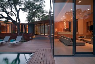 Contemporary Patio with Raised beds, Pond, Pathway, exterior stone floors