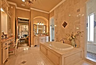 Mediterranean Master Bathroom with Ballade recessed oval tub, Framed Partial Panel, Bathtub, Drop-in sink, six panel door