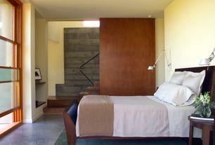 Modern Master Bedroom with Built-in bookshelf, Concrete floors