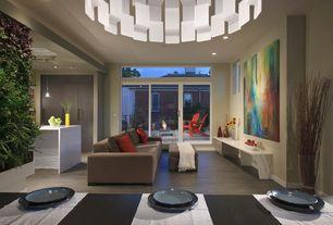 Modern Great Room with Chandelier, Transom window, Built-in bookshelf, slate tile floors