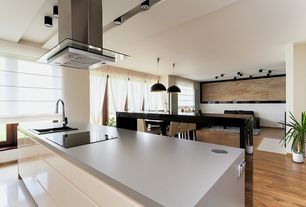 Modern Kitchen with Undermount sink, Corian Pearl Grey Solid Surface, Slate counters, flush light, Hardwood floors