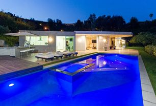 Contemporary Swimming Pool with Raised beds, Outdoor kitchen, Pool with hot tub, exterior tile floors