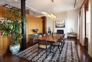 Contemporary Dining Room with High ceiling, Columns, Chandelier, Hardwood floors, interior brick