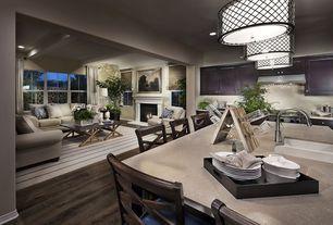 Contemporary Great Room with Pendant light, Built-in bookshelf, Hardwood floors