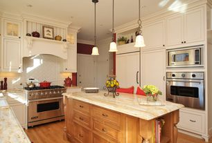 Traditional Kitchen with full backsplash, U-shaped, Crown molding, wall oven, Complex marble counters, Inset cabinets