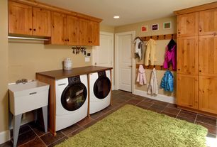 Country Laundry Room with travertine tile floors, Farmhouse sink, specialty door, Chandra Celecot - Green Area Rug 5' x 7'6