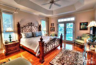 Mediterranean Master Bedroom with French doors, Paint, Crown molding, Transom window, Hardwood floors, Standard height
