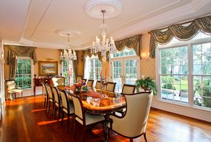 Traditional Dining Room with Crown molding, Hardwood floors, Chandelier, Transom window, Wall sconce, French doors
